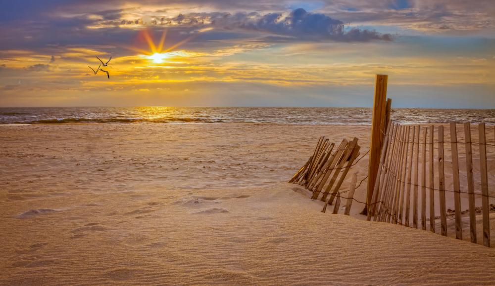 Many enjoy the sunsets and soft sands of the barrier island.