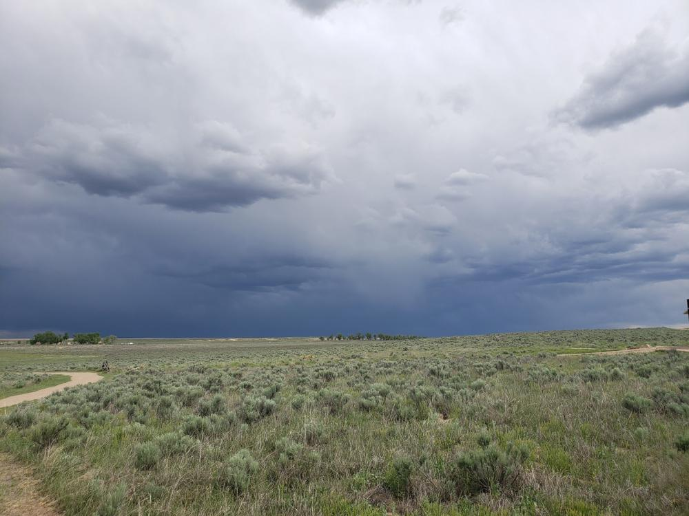 Dark cloudy skies over grassland at Sand Creek Massacre National Historic Site, Colorado