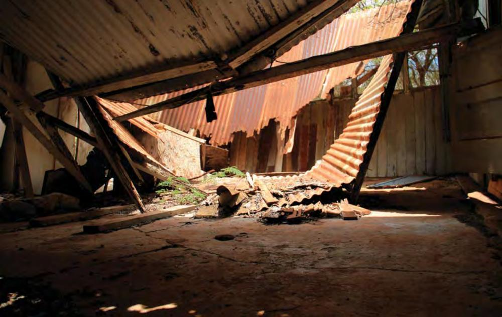Collapsed, rusted roof inside abandoned building in former Honouliuli Internment Camp, Hawaii