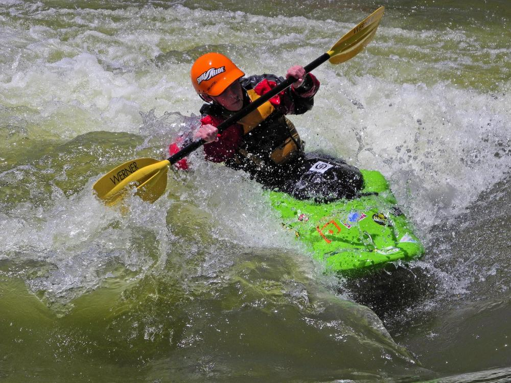 A whitewater kayaker paddles through the Rio Grande River