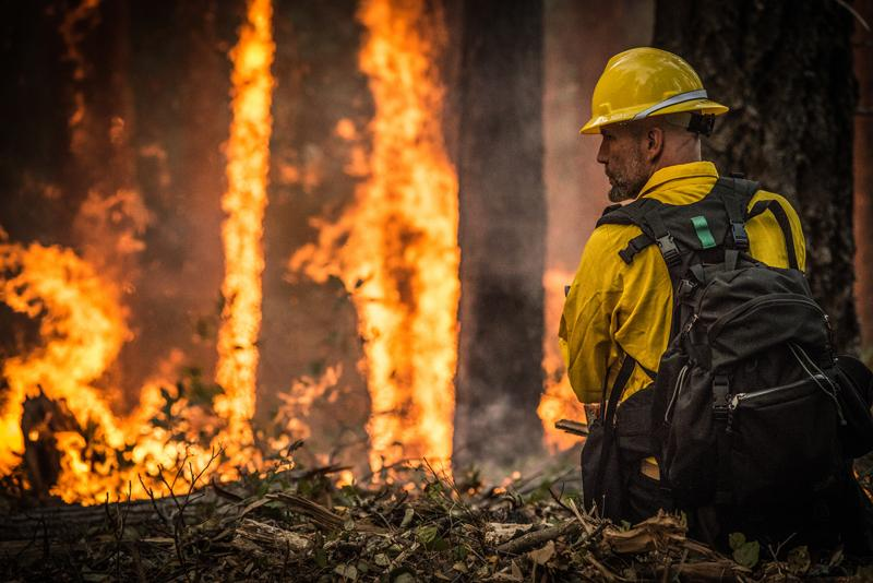A firefighter in Oregon oversees a prescribed burn to help stop a larger wildfire.